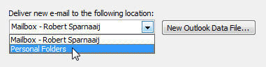 Changing default delivery location in Outlook 2003. (click on the image for a view of the full dialog)